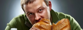 young-man-eating-bread-550x200.jpg